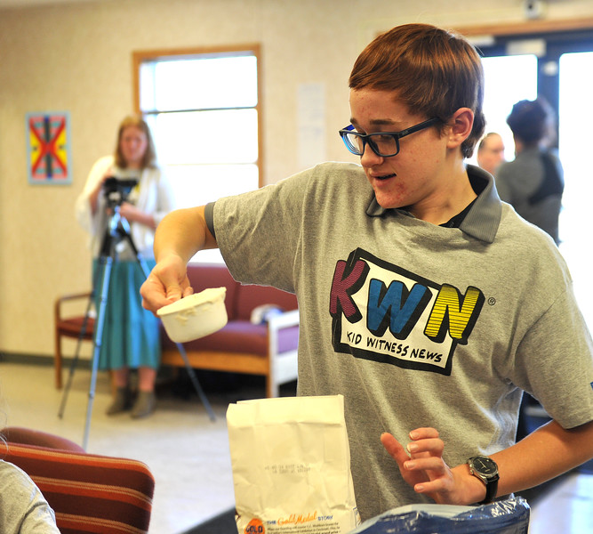 Ryan Patterson | The Sheridan Press<br /> Sheridan Junior High School eighth-grader Cameron Reckord scoops flour during a cultural event at the Art Culture and Elder's Center in Wyola, Montana, Tuesday, Nov. 20, 2018. About 15 students from each school spent more than two hours doing several different activities.