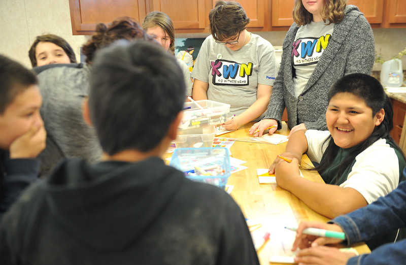 Ryan Patterson | The Sheridan Press<br /> Wyola School student Chance Pretty On Top, right, laughs with other students during a cultural event at the Art Culture and Elder's Center in Wyola, Montana, Tuesday, Nov. 20, 2018. About 15 students from each school spent more than two hours doing several different activities.