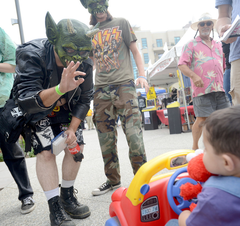 . Hugoroth waves to Emmanuel Juarez at the annual Long Beach Zombie Walk in Long Beach, CA. on Saturday, October 26, 2013. (Photo by Sean Hiller/Press Telegram).