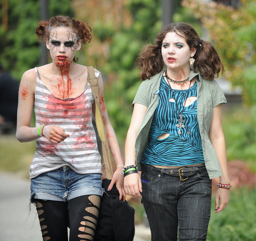 . Alia McDaniel of Claremont, left, and Sam Gardina of Long Beach join the undead to invade downtown during the annual Long Beach Zombie Walk in Long Beach, CA. on Saturday, October 26, 2013. (Photo by Sean Hiller/Press Telegram).