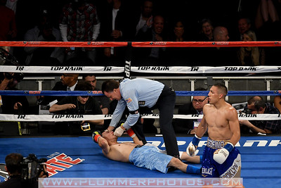 TEOFIMO LOPEZ III (gold and blue trunks) and RONALD RIVAS battle in a lightweight bout at Madison Square Garden in New York.