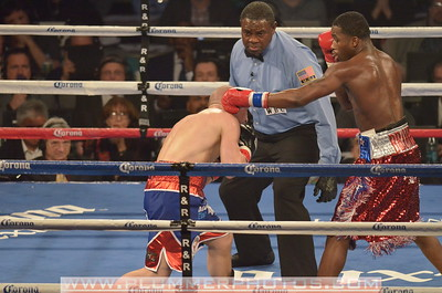 ADRIEN BRONER (red trunks) and GAVIN REES battle in a Lightweight bout at Boardwalk Hall in Atlantic City, New Jersey.