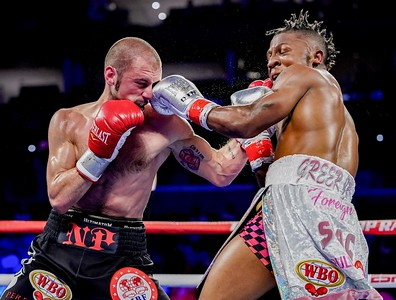 NIKOLAI POTAPOV (black and red trunks) and JOSHUA GREER battle in a NABO Title & IBF Eliminator bout at the Prudential Center in Newark, New Jersey.