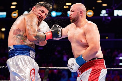 ADAM KOWNACKI (white and red trunks) battles CHRIS ARREOLA in a heavyweight bout at the Barclays Center in Brooklyn, New York.
