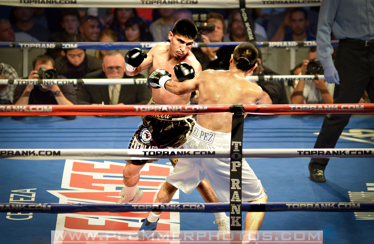 October 22, 2011- Mikey Garcia goes on the attack against Juan Carlos Martinez. Garcia would eventually win the featherweight bout via TKO at 2:46 of the fourth round in the WaMu Theater at Madison Square Garden in New York City.