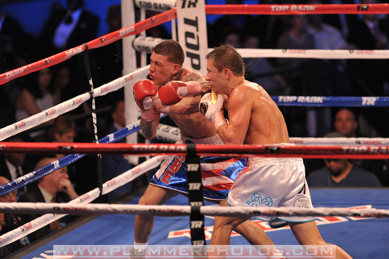 GABRIEL ROSADO  (blue and white trunks) and GENNADY GOLOVKIN battle in a WBA and IBO World Middleweight Title bout at Madison Square Garden in New York City, New York.