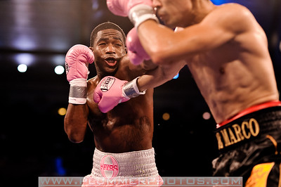 ADRIEN BRONER (pink trunks) throws a jab at ANTONIO DEMARCO in their lightweight title bout at Boardwalk Hall in Atlantic City, New Jersey.