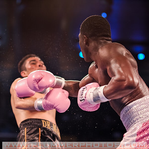 ADRIEN BRONER (pink trunks) knocks   ANTONIO DEMARCO backwards during their lightweight title bout at Boardwalk Hall in Atlantic City, New Jersey.