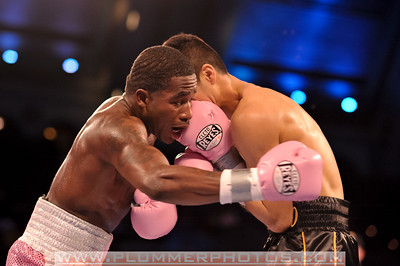 ADRIEN BRONER (pink trunks) throws a a shot at the body of ANTONIO DEMARCO in their lightweight title bout at Boardwalk Hall in Atlantic City, New Jersey.