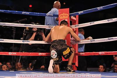 ANTONIO DEMARCO prays before his lightweight title bout against Adrien Broner.