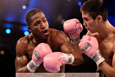 ADRIEN BRONER (pink trunks) and  ANTONIO DEMARCO exchange punches during their lightweight title bout at Boardwalk Hall in Atlantic City, New Jersey.