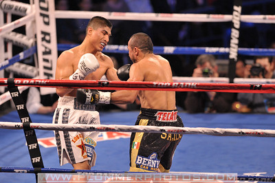 MIGUEL ANGEL GARCIA (white trunks) and ORLANDO SALIDO battle in a WBO World Featherweight Title bout at Madison Square Garden in New York City, New York.