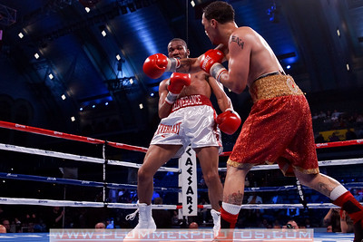 JULIAN MITCHELL (left) defeats HECTOR ROSARIO by decision as part of the Bernard Hopkins versus Chad Dawson II undercard.