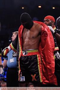 NAAZIM RICHARDSON unrobes BERNARD HOPKINS before his WBC and Ring Magazine Light Heavyweight title fight.