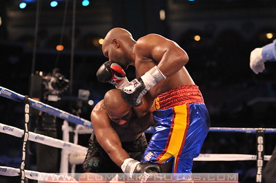 A dazed SETH MITCHELL attempts to hold on to JOHNATHAN BANKS in a heavyweight title fight at Boardwalk Hall in Atlantic City, New Jersey.