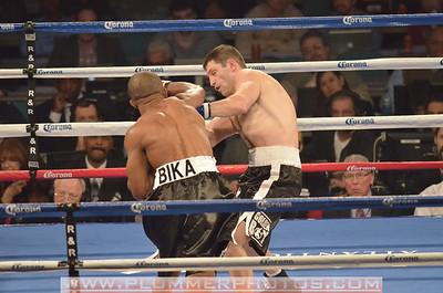 NIKOLA SJEKLOCA and SAKIO BIKA (black trunks) battle in a Super Middleweight bout at Boardwalk Hall in Atlantic City, New Jersey.