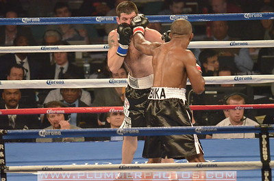 NIKOLA SJEKLOCA and SAKIO BIKA (red taped gloves) battle in a Super Middleweight bout at Boardwalk Hall in Atlantic City, New Jersey.