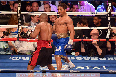 DEVON ALEXANDER (black and red trunks) and SHAWN PORTER MALIGNAGGI battle in an IBF welterweight title bout at the Barclays Center in Brooklyn, New York.