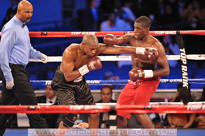 STEVEN TYNER and RONALD ELLIS (red trunks) battle in a Super Middleweight bout at Madison Square Garden in New York City, New York.