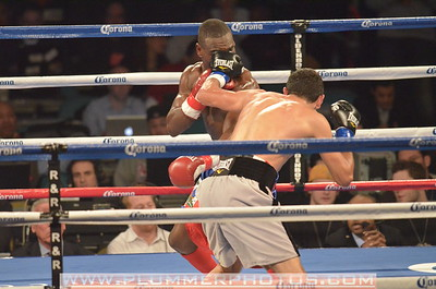 VICENTE ESCOBEDO and EDNER CHERRY (blue and red trunks) battle in a Junior Lightweight bout at Boardwalk Hall in Atlantic City, New Jersey.