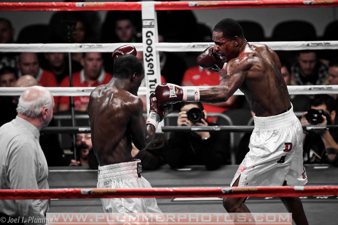 December 17, 2011- Cornelius White (left) continues to battle Yordanis Despaigne (right) after an unintentional head butt opens a cut over his left eye. White eventually pulled off the upset winning by unanimous decision (60-53, 59-55, 59-55) in this light heavyweight bout held at Boardwalk Hall in Atlantic City, New Jersey.