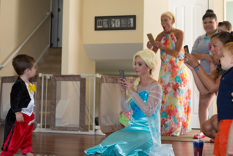 An outtake of Cate and Cinderella's audience.  Pete is watching what all the adults are doing on their phones.  Ha!