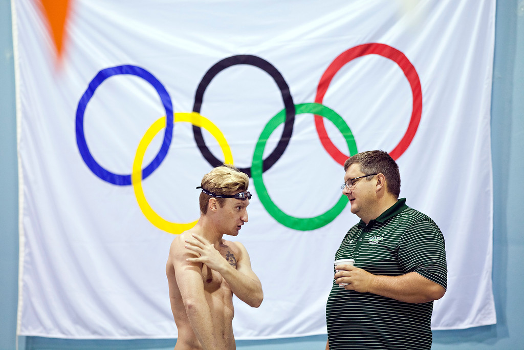 Paralympian Brad Snyder, who was blinded in an IED attack while serving in Afghanistan, trains with Loyola University Maryland swim coach Brian Loeffler at the Meadowbrook Aquatic Center in Baltimore July 31.<br /> TOM McCARTHY JR. | CR STAFF