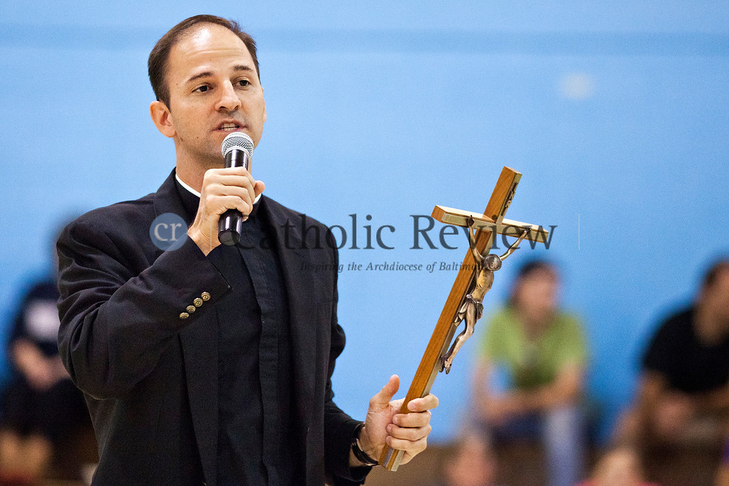 Fathor Michael DeAscanis Vocations Director for the Archdiocese of Balitmore, talks to the crowed before the start of basketball game between priests and seminarians from around the archdiocese and parishioners Sept 14.TOM McCARTHY JR. | CR STAFF