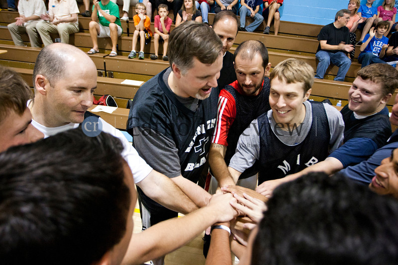 Priests and seminarians from around the Archdiocese of Baltimore bring it in for a cheer before taking on parishioners in a hard-fought basketball game Sept 14.TOM McCARTHY JR. | CR STAFF