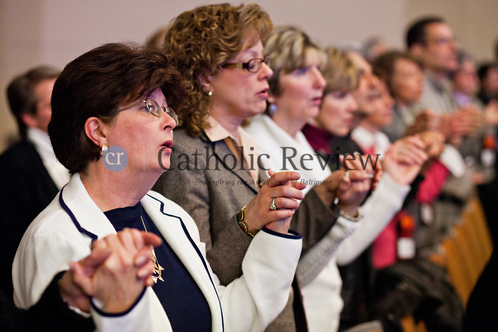 TOM McCARTHY JR. | CR STAFF<br /> Worshippers join hands as the recite the Our Father during the Mass celebrated by Archbishop William E. Lori at the Mid-Atlantic Congress in Baltimore March 8.