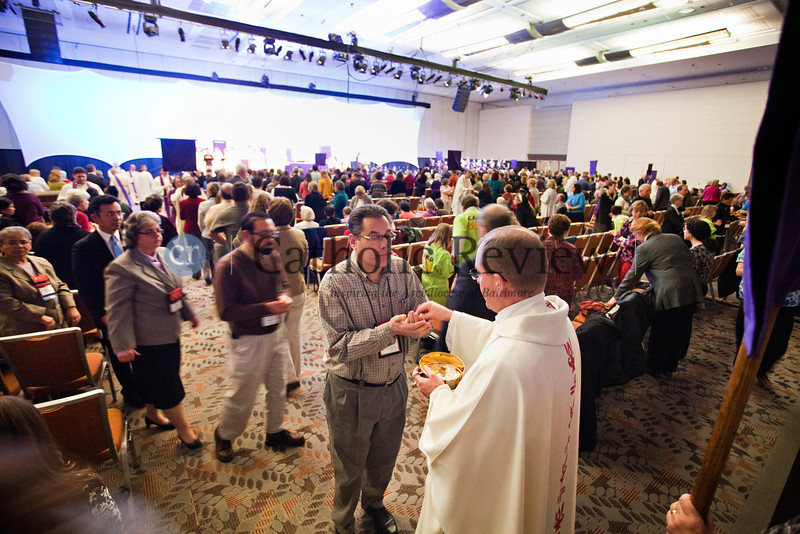 TOM McCARTHY JR. | CR STAFF<br /> Worshippers recieve the Eucharist during the Mass celebrated by Archbishop William E. Lori at the Mid-Atlantic Congress in Baltimore March 8.