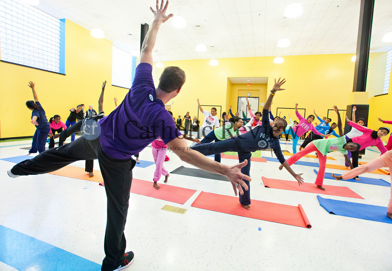 TOM McCARTHY JR. | CR STAFF <br /> Jacob Lupo from Brick Bodies leads students at Mother Seton Academy in Baltimore through a body flow yoga class Jan 10.
