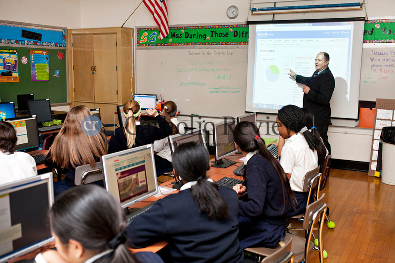 TOM McCARTHY JR. | CR STAFF <br /> Eighth-drade social studies teacher Carl Berger talks to his class about using internet to find source materials online at St. Mark School in Catonsville Jan. 9.