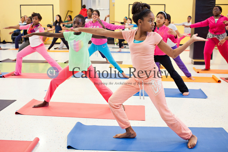 TOM McCARTHY JR. | CR STAFF <br /> Seventh-grader Nautika Hall joins her school mates in a body flow yoga class lead by Jacob Lupo from Brick Bodies at Mother Seton Academy in Baltimore Jan 10.