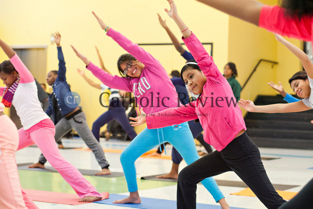 TOM McCARTHY JR. | CR STAFF <br /> Students at Mother Seton Academy in Baltimore participate in a body flow yoga class lead by Jacob Lupo from Brick Bodies Jan 10.