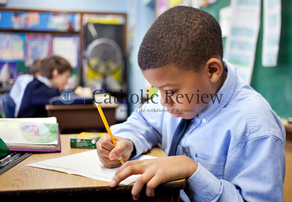 TOM McCARTHY JR. | CR STAFF <br /> Fourth-grader Noah Owens works on drawings of plant and animal cells in science class at St. Michael the Archangel School in Overlea Jan. 9.