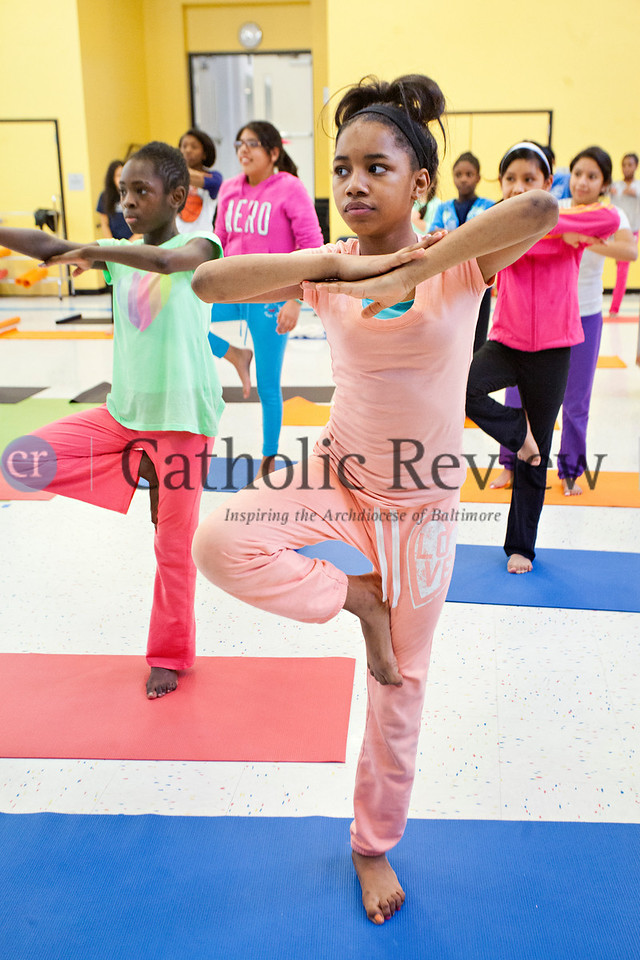 TOM McCARTHY JR. | CR STAFF <br /> Seventh-grader Nautika Hall balances on one leg as she and her school mates participate in a body flow yoga class lead by Jacob Lupo from Brick Bodies at Mother Seton Academy in Baltimore Jan 10.