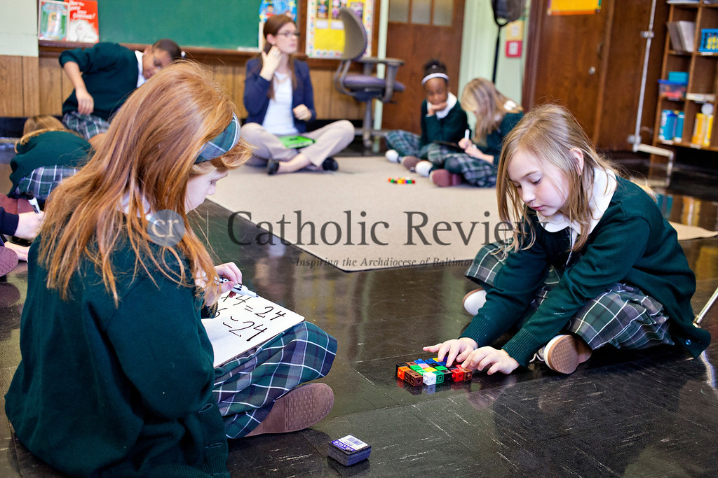 TOM McCARTHY JR. | CR STAFF<br /> Summer Zubey and Hayley Lijewski use counter blocks to do multiplication problems in Kathleen Smith's third grade class at St. Michael the Archangel School in Overlea Jan. 9.