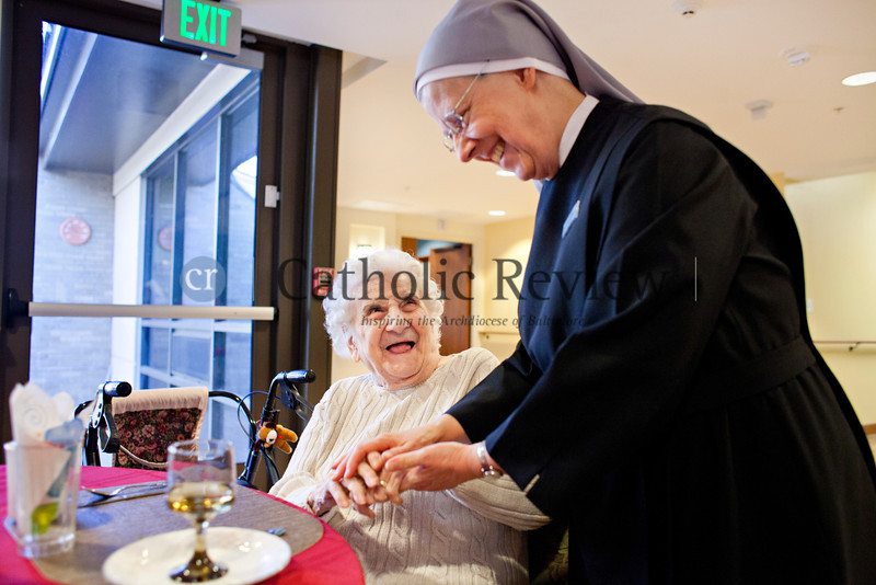 TOM McCARTHY JR. | CR STAFF<br /> Rose Dente, 101, a resident of a resident of St. Martin's Home for the Aged, talks with Sister Lawrence Mary Jan. 9.
