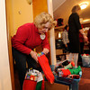 Students from St. Louis School in Pittsford deliver stocking gifts that St. Louis families bought for children living at St. Joseph's Villa.
