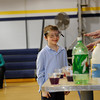 Tim Cawley, head of Theater and Outreach for Rochester Museum an Science Center, does science experiments with students at Holy Cross School in Charlotte.