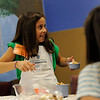Girls in grades 5-8 learn kitchen techniques and homemade healthy recipes from teachers Mrs. McCormack and Mrs. Paluskiewicz during cooking camp at Our Lady of Mercy High School.