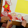Students at St. Rita School in Webster make posters to give to the West Webster Fire Department and Webster Police Department one month after the tragic shooting of two firefighters in West Webster.