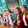 Siena Catholic Academy students join hands in prayer at Brighton's St. Thomas More Church.
