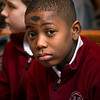Sixth grader Gabe Zawolo sits after receiving ashes at Brighton's St. Thomas More Church March 1.