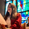Mary Grace Magguilli sings in the choir loft before Mass at Brighton's St. Thomas More Church.