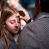 Siena Catholic Academy student Caitlyn Hancock receives ashes during an Ash Wednesday Mass at Brighton's St. Thomas More Church March 1.