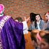 Meghan Gleason listens to Bishop Salvatore R. Matano give the homily during the Ash Wednesday Mass at Brighton's St. Thomas More Church.