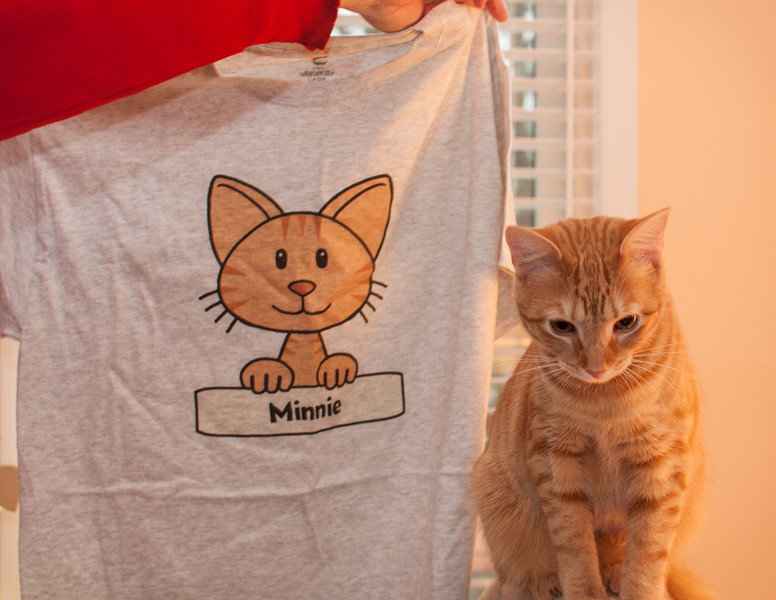 Minnie posing with my mother's t-shirt, a gift from my father.