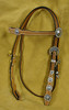 <b>Lot 10 - Brow Band Headstall with Sterling Silver Conchos</b> This brow band headstall is a hand made headstall with hand engraved sterling silver overlay concho's and buckle sets. Retail value $550. Click on photo to see a larger image. Donated by Hansen Silver - Tim & Marie Hansen, Oakdale, CA <b>Purchased by Kyle Colyer, ID for $425.00</b>